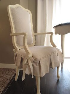 reupholstered with a canvas painters drop cloth...beautiful