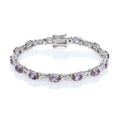 Oval Amethyst gemstones set in a Sterling Silver bracelet.