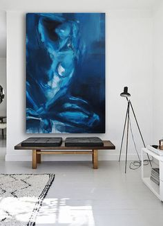Large figure painting, modern art styling in home. Details of blue, teal, grey, white. Original canvas art available online