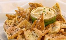 Pita crisps with Hummus This popular Middle Eastern dip makes a wonderful snack or appetizer! Use Dempster's® Pita Pockets to make homemade herbed pitas for dipping. - Spring, Appetizer, Grey Cup, Dip/Spread, Summer, Winter, Bread, Thyme, Super Bowl, Middle Eastern, Basil, Fall, Snack