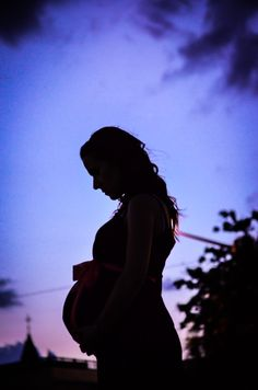 Maternity Photoshoot -  Silhouette - My sister -  8 months pregnant. Notice the church on the bottom left corner..