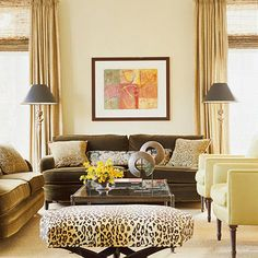 """Above the Sofa  """"People have a tendency to hang art too high,"""" says Linda Crisolo, Art.com director of merchandising. """"The center of the image should be at eye level."""" In living rooms, people are usually sitting, so artwork should be lower. A good way to ensure you're placing artwork at the right height is to hang it one hand width above the sofa."""