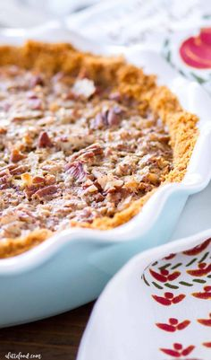 This German Chocolate Pecan Piecombines the classic pecan pie recipe (made without corn syrup) with the amazing flavors of German chocolate! This German Chocolate Pecan Pie is made in a homemade graham cracker crust, and is rich, sweet, and the perfect Thanksgiving dessert (or Christmas dessert) addition!
