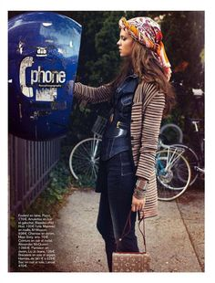 bohemian attire.  Rare to see a phone booth these days.