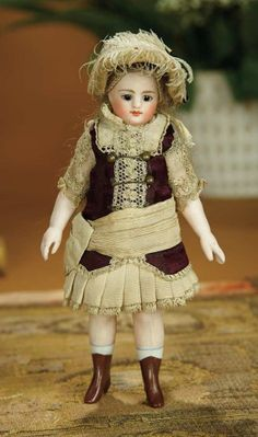 "6""- French All-Bisque Mignonette, Fashionable Costume & Painted Brown Ankle Boots~~~ long hip-length mohair wig, peg-jointed bisque arms & legs, painted white socks & brown ankle boots w/ little heels.  French, circa 1880. The  doll is wearing original brown silk faille dress with lace & ivory silk faille trim, original undergarments & fancy bonnet."