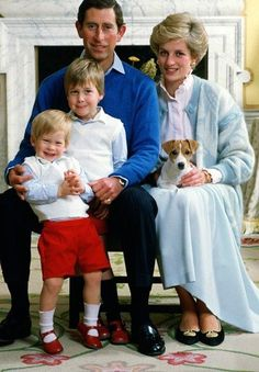 Prince Charles, Princess Diana, and Princes William and Harry with Tigga in 1986