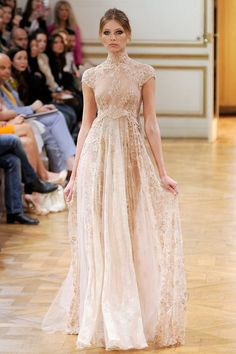haute couture zuhair... Reminds me of my wedding dress..... lace, with high neck and cap sleeves.
