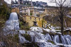 Orbaneja del Castillo (Burgos Spain) is a tiny village crossed by an awesome waterfall. [1280x853]