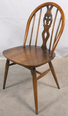 """6 Decorating Ercol Kitchen Chairs 6 Decorating Ercol Kitchen Chairs """"The old man would about-face in his grave at that,"""" Ercol's administrator Edward Tadros says cheerfully. Ercol Dining Chairs, Ercol Chair, Ercol Furniture, Kitchen Chairs, Armchair, 1950s Design, Kitchen Styling, Old Things, House Design"""