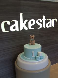 Cake: First Birthday Cake with little fondant bear. The customer wanted this cake super-simple. I definitely agree that less is more here!  www.cakestar.com.au  Jade Lipton xx
