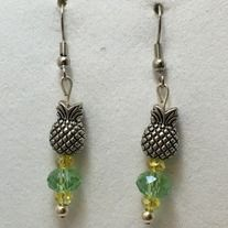 Green and yellow crystal beads and silver plated pineapple beads dangle earrings. Made with silver plated non tarnish hypoallergenic nickel free materials.