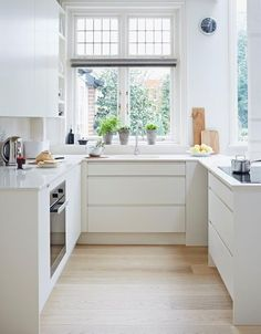 We have chosen our narrow galley kitchen design ideas that will help your kitchen look stylish and practical.