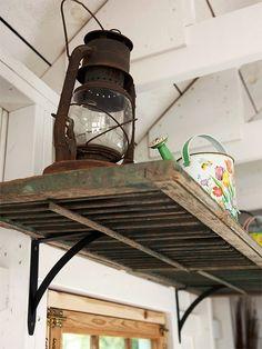 Use old shutters for shelves in potting shed. Shutter shelf via BHG Old Window Shutters, Repurposed Shutters, Vintage Shutters, Old Shutters Decor, Metal Shutters, Bedroom Shutters, White Shutters, Window Frames, White Walls