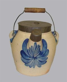 "Sold for $ 1,495        STONEWARE BATTER JUG. Impressed ""Cowden & Wilcox, Harris[burg, Pennsylvania]"", ca. 1880. Bold cobalt blue flowers. Two tin lids and a wire bale handle. Minor damage. 8 1/4""h."