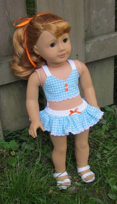 Get your doll ready for hot summer days with this bathing suit. This is made from an aqua and white gingham cotton fabric. The top is lined