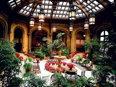 Winter Garden of Biltmore House decorated for the holidays. Description from pinterest.com. I searched for this on bing.com/images