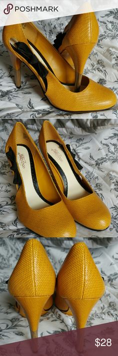 """Lela Rose for Payless yellow heels with black bows Lela Rose mustard/golden yellow heels with adorable black bow, about 4"""" heel. Great condition, only worn once! I love this color, just in time for fall! These would be great with a skinny jean for a night out or pencil skirt for the office! No trades. Lela Rose Shoes Heels"""