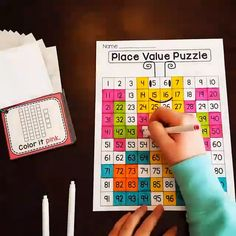 Place Value Puzzle Center Watch this video of how her fun Place value games in the form of 100 chart puzzles reveal a cute picture after kids look at each card with base 10 blocks that tells them what color to make each number - these are so cool! Preschool Learning, Teaching Math, Math Activities, Math Resources, Base Ten Activities, Montessori Kindergarten, Teaching Place Values, Learning Place, Early Finishers Activities