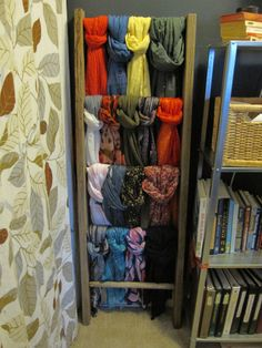 Scarf organization on a salvaged ladder {Folksy Home}. It would also look good mounted to the wall with brackets that make it protrude