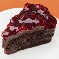 This simple chocolate cake recipe is moist and delicious and is made with simple ingredients. We also give instructions for a fresh berry sauce.