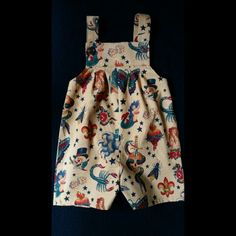 British made by Vincent and Valerie tattoo print overalls or dungarees. Gorgeous Alexander Henry fabric. Made to order stylish clothing for boys and girls