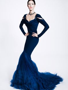...a form fitted dress with a trumpet tail, like this Zac Posen Pre-Show 2012 dress
