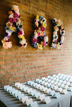 #initials, #escort-cards, #seating-chart, #backdrop  Photography: Pen/Carlson - pencarlson.com  Read More: http://www.stylemepretty.com/2014/09/02/eclectic-chicago-loft-wedding/