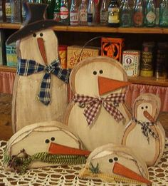 Hand crafted wood snowmen at The Merchant General Store.
