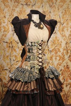 @: Love the layers of ruffles in various colors attached to the corsets....vest with lacing put in....