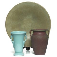 """Art Pottery bowl, low flared form in yellow and green, marked, 12.5""""w; with an Art Pottery vase, double handled form in green, unmarked, 6""""h, chip to foot and handle; with an Art Pottery vase, double handled form in maroon, unmarked, 6.5""""h 200-300"""