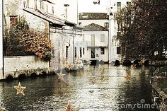 Sparkling star decorations and bridge on Sile river during winter holidays, in vintage hues, in Treviso city, in Veneto, Italy. Sparkling Stars, Star Decorations, Christmas Star, Winter Holidays, Bridge, Italy, River, Stock Photos, Street