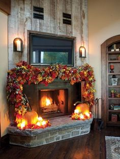 FALL HOME DECOR: If you typically opt for a more minimalist decorating approach, punch up your mantel with a single statement piece. Here, one decorator used a garland of colorful leaves and a couple pumpkins to add drama to a fireplace. Halloween Chic, Halloween Mantel, Halloween Cakes, Thanksgiving Decorations, Seasonal Decor, Holiday Decor, Halloween Decorations, House Decorations, Harvest Decorations