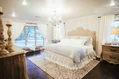 For the master bedroom Joanna incorporated a chandelier and an antique closet door on a slider to add character and charm to the newly renovated bedroom. Chip and Jo added new windows, flooring and trim to update the space and Joanna selected beautiful linens by Bella Notte to complete the look.