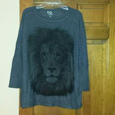 Go Couture lion sweater Worn once, exc condition grey lion sweater. Rayon, polyester, spandex material. Bought as new from another posher and wore once but not really my style. Looks great with leggings. Paid 34, my price is firm. go couture Sweaters Crew & Scoop Necks