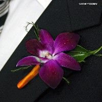 Wedding Flowers - Purple flowers - TIFFANI's Black Wedding by Color Blog  do you like this for guys or not? please respond