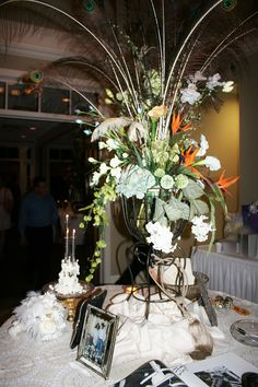 Wedding Cake table with pearls, jewels and peacock feathers