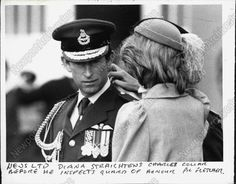 Diana straightens Charles's collar before he inspects the Guard.