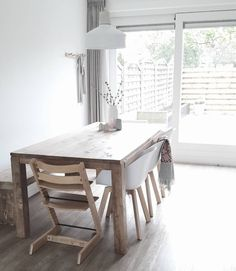 We love this minimal yet rustic kitchen table! The white and wood matches perfectly for a cozy and chic home look.