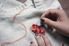 sewing embroidery on a sweater (hadn't thought of this - stained sweater is saved!)