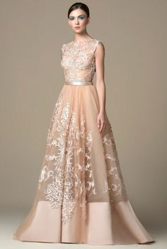 Saiid Kobeisy long gilded beige tulle dress with a lightly beaded round-neck top and fully embellished with laser-cut patterns and a crepe skirt hem . Tulle Dress, Dress Up, Saiid Kobeisy, Fancy Gowns, Plus Size Gowns, Classy Women, Classy Lady, Crepe Skirts, Embellished Gown