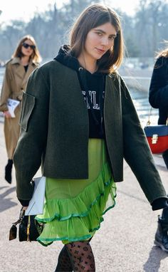Navy cropped sweatshirt, olive coat, green ruffled skirt, and Louis Vuitton tights