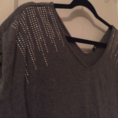 V-Neck Top Grey V-neck Express top with silver rhinestones ... Any questions feel free to ask ☺️ Express Tops Blouses