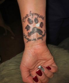 Once by my side.. Always in my heart... it reads & that is the dogs actual paw print! Love it!