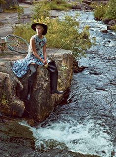 A River Runs Through It Kloss casts her line in the Pite River, home to the Storforsen rapids, among the largest in Europe. Rochas sleeveless dress. Saint Laurent by Hedi Slimane hat. Photographed by Patrick Demarchelier, Vogue, December 2014
