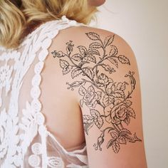 Large black and white floral tattoo