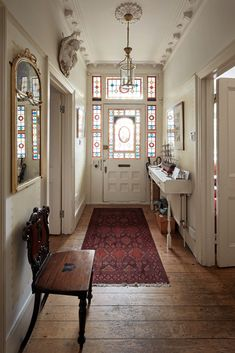 The entry in a Victorian townhouse in Southwest London features decorative origi. - The entry in a Victorian townhouse in Southwest London features decorative original stained glass w - Victorian Hallway, Victorian Townhouse, Victorian Interiors, Victorian Home Decor, Victorian House London, Victorian Windows, Edwardian House, London House, Victorian Era