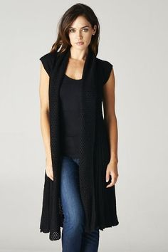 Black Sleeveless Knit Long Sweater is a fall trend. Add the perfect skinny jeans to complete the look.