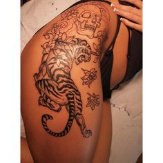 tiger tattoo w/out the skull on thigh .. i dont like skulls so i would... ❤ liked on Polyvore featuring accessories