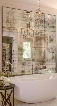 Beautiful antiqued mirror and vintage white bathtub