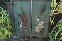Carved redwood gate by Mogens Abel, restored by Lynne Rutter